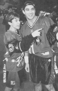 Scan from Tiger Beat 1997 - Jonathan Taylor Thomas and Dean Cain at the MTV Rock n' Jock Football