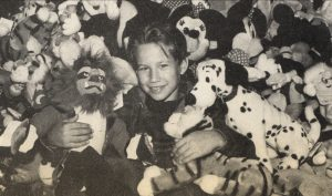 Jonathan Taylor Thomas in a pile of Disney plush toys while visiting the Disney souvenir store in Cleveland, Ohio.