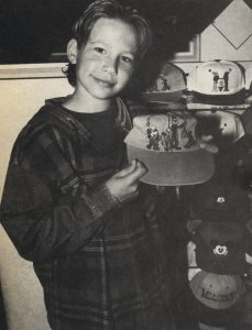 Jonathan Taylor Thomas with a fishing cap visiting the Disney souvenir store in Cleveland, Ohio.
