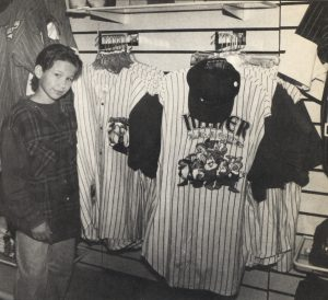 Jonathan Taylor Thomas inspects the Baseball shirt selection at the Disney souvenir store in Cleveland, Ohio.