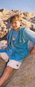 Jonathan Taylor Thomas climbing rocks