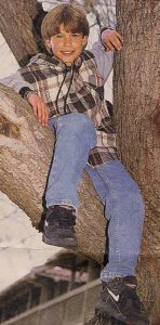 Jonathan Taylor Thomas climbing a tree