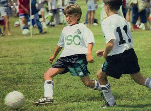Jonathan Taylor Thomas playing football.